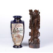 Japanese Satsuma vase of square tapering form and signature beneath, 25cm high and a carved figure