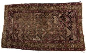 Persian rug with geometric stylised central panel and foliate border, 158cm x 89cm