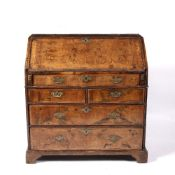Walnut bureau George III, with fall front, enclosing drawers, pigeon holes and compartments, above
