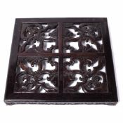 Hardwood low stand Chinese, with four carved panels to the top, possibly Zitan, 63cm across, 7.5cm