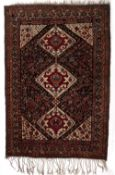 Qashqai blue ground tribal rug with three central medallions and further stylised foliate animal and