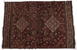 Caucasian dark blue ground rug with two medallions and panels of stylised birds to the border, 188cm