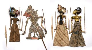 Javanese leather shadow puppet 81cm, and three painted wooden Javanese puppets, 53cm - 69cm, (4)