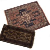 Belouch rug with central shaped panel and foliate designs,136cm x 70cm and a Hamadan red ground