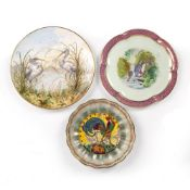 Three English porcelain plates with bird decoration, comprising a Minton dish with a crowing