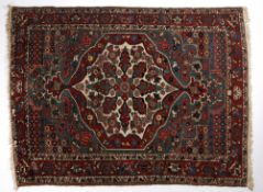 Hamadan blue ground rug with central foliate shaped medallion, and red ground foliate border 194cm x
