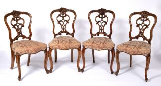 Set of four dining chairs Victorian, with pierced scrolling vase shaped splat and overstuffed
