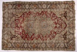 Persian red ground rug with central foliate medallion and banded border, 123cm x 82cm