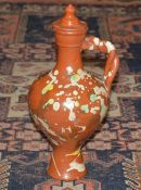 Pottery Channakale jug Turkish, of baluster form with painted decoration, 34cm high