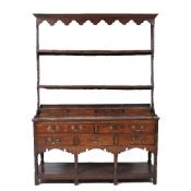 Oak dresser George III, with open top shelves and drawers to the base, on stile feet, 133cm wide x