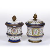 Near pair of French porcelain jars and covers with ormolu mounts decorated with flowers and Sèvres