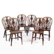 Near set of six 'Oxford' elm and ash wheel-back chairs with stretcher supports, one stamped to the