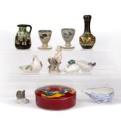 Collection of pieces to include: Royal Copenhagen porcelain figures, Poole pottery lidded box,