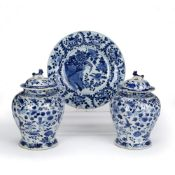 Pair of lidded blue and white vases Chinese, 19th Century, decorated to the exterior with birds in