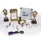 Brass cased carriage clock French, with Roman numerals, two silver plated trophies on stands,