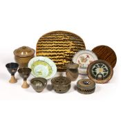 Collection of studio pottery to include: two combed slipware dishes, salt glazes storage pot and