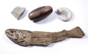 Four large fossil/specimens including ammonite, fossilised fish 86cm, a Shiva Lingam stone stand