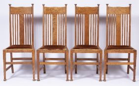 Attributed to Liberty & Co Set of four Arts and crafts oak dining chairs, unmarked, 105.5cm high (4)