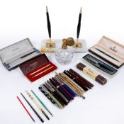 Group of Parker and other pens a desk stand and a glass and gilt metal atomiser Condition: at