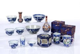 Group of Chinese and Japanese pieces including four Chinese blue and white wine cups, each with