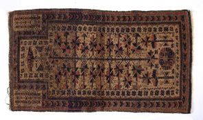Beluch rust ground rug with stylised medallions, 150cm x 82cm Condition: Some fraying to the edges