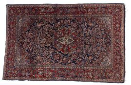 Persian blue ground rug, with central foliate medallion, trailing foliage and red ground border,