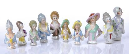 Collection of porcelain pincushion ladies some with faint impressed numbers to the reverse (10)