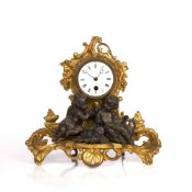 Mantel clock late 19th Century, with gilt painted scrolling acanthus decoration, the white enamel