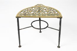 Iron and brass trivet 19th Century, of semi-circular form, 42cm x 33cm x 36cm Condition: some wear