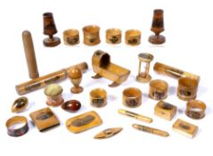 Collection of Mauchline ware to include: hourglass, pincushion, bobbins, thimble holders, candle