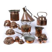 Collection of copper items to include: kettle on stand, jelly moulds, measures, pan, etc