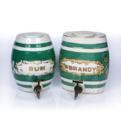 Two ceramic kegs with green and white striped decoration, 'P. Brandy' and 'Rum', both taps are