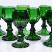 Group of twenty one green wine glasses possibly Scandinavian, each of fluted form with trumpet bases