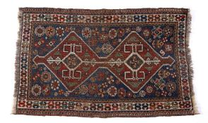 Caucasian blue ground rug with red ground central double medallion, and with stylised foliate