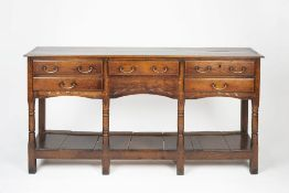 Oak dresser base 18th Century, fitted drawers with brass handles and with pot board below, 165cm