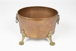 Copper and brass log bin with lion mask handles, standing on paw feet, 38cm x 30cm Condition: at
