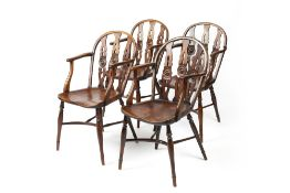 Set of four yew and elm wheel-back Windsor elbow chairs George III, each with three rail back and