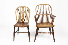 Yew-wood and elm Windsor chair 19th Century, with arched stick-back and solid seat, 57cm across,