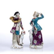 Pair of Chelsea style porcelain figures of the hunter and the huntress, with gold anchor marks to