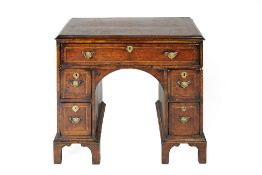 Walnut and herring-bone inlaid kneehole desk 18th Century, fitted one long and four smaller