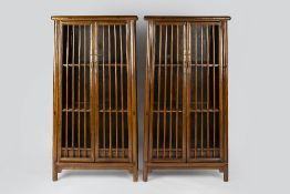 Pair of Ming style elm cabinets Chinese, each with slatted doors enclosing shelves with brass