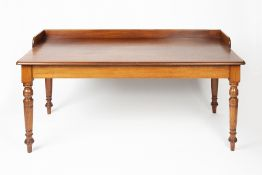 Large mahogany writing/library table 19th Century, having a raised back on turned supports, 158cm