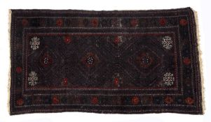 Large Beluch burgundy rug with three central medallions and panelled border, 240cm x 127cm