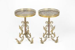 Pair of marble and gilt metal occasional tales with foliate supports terminating in putti, 30cm