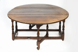 Large oak gate-leg dining table 18th Century, with two drop leaves and turned supports, 154cm