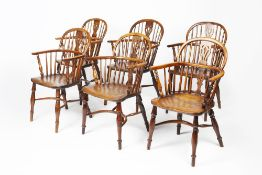 Near set of six yew-wood and elm Windsor elbow chairs 19th Century, each with pierced splat back,