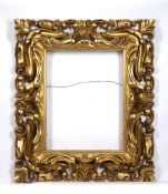 A 19TH CENTURY FLORENTINE CARVED GILTWOOD FRAME, rebate size 58.5 x 45.5cm