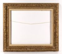 A LOUIS XIII STYLE COMPOSITION AND GILT FRAME, the borders moulded with flowers and foliage,
