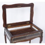 A LOUIS XV STYLE ROSEWOOD AND GLAZED TABLE TOP BIJOUTERIE CABINET of shaped rectangular form, the