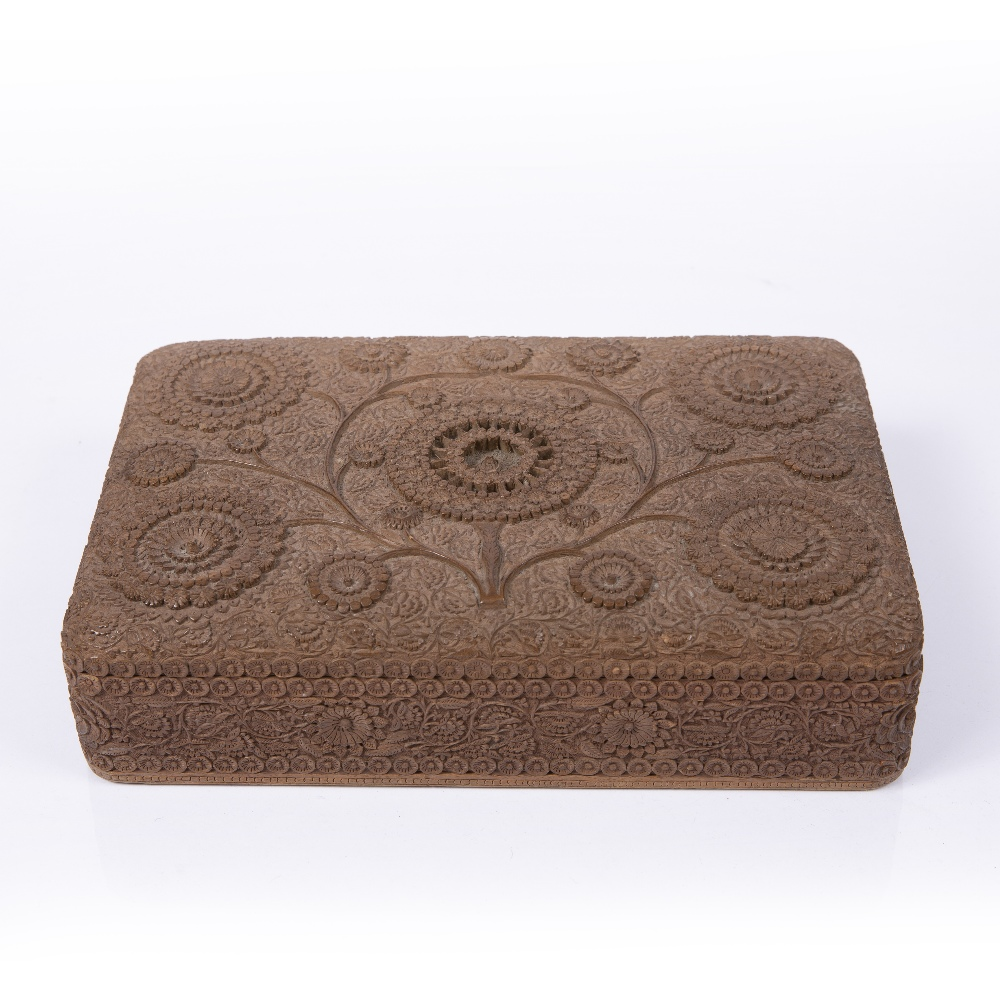AN ANGLO INDIAN SANDALWOOD BOX AND COVER, all over finely carved with scrolling and flowering